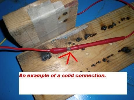 Picture of See the Solid Electrical Connection. See Its Location, in the Center of the Wood Insulator Plank.